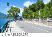 Купить «Tremezzo, Lake Como, Italy - July 6 2018: A view of the shores of Lake Como (northern Italy) on a sunny day», фото № 28809270, снято 6 июля 2018 г. (c) Григорий Стоякин / Фотобанк Лори