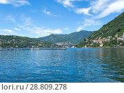 Купить «Lake Como, Italy - July 6 2018: View of Lake Como (northern Italy) in a sunny day», фото № 28809278, снято 6 июля 2018 г. (c) Григорий Стоякин / Фотобанк Лори