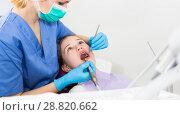 Купить «Girl getting dental treatment», фото № 28820662, снято 1 марта 2018 г. (c) Яков Филимонов / Фотобанк Лори