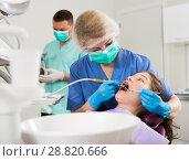 Купить «Female dentist performing treatment for girl with assistant», фото № 28820666, снято 1 марта 2018 г. (c) Яков Филимонов / Фотобанк Лори