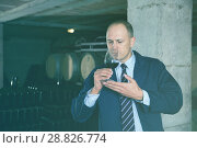 Купить «Sommelier tasting red wines in winery basement», фото № 28826774, снято 22 января 2018 г. (c) Яков Филимонов / Фотобанк Лори