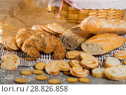 Купить «Wheat and grain baguettes, croissants and biscuits on wicker mat», фото № 28826858, снято 30 января 2018 г. (c) Яков Филимонов / Фотобанк Лори