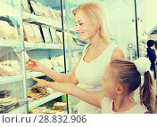 Купить «mother with daughter buying chilled foods in supermarket», фото № 28832906, снято 16 января 2019 г. (c) Татьяна Яцевич / Фотобанк Лори
