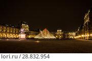 Купить «Museum Louvre at night with red flash in pyramid», фото № 28832954, снято 5 сентября 2014 г. (c) Сурикова Ирина / Фотобанк Лори