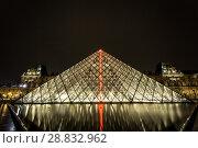 Купить «Museum Louvre at night with red flash in pyramid», фото № 28832962, снято 5 сентября 2014 г. (c) Сурикова Ирина / Фотобанк Лори