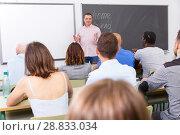 Купить «Young lecturer talking to mixed age students», фото № 28833034, снято 28 июня 2018 г. (c) Яков Филимонов / Фотобанк Лори