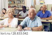 Купить «Elderly man and woman take a written exam», фото № 28833042, снято 28 июня 2018 г. (c) Яков Филимонов / Фотобанк Лори