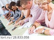 Group people listening and writing during course. Стоковое фото, фотограф Яков Филимонов / Фотобанк Лори