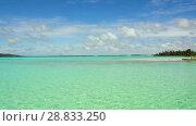 Купить «lagoon at tropical beach in french polynesia», видеоролик № 28833250, снято 3 июля 2018 г. (c) Syda Productions / Фотобанк Лори