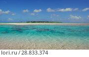 Купить «lagoon at tropical island beach in french polynesia», видеоролик № 28833374, снято 1 июля 2018 г. (c) Syda Productions / Фотобанк Лори