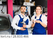 Купить «Two mechanics discussing list of works», фото № 28833466, снято 4 апреля 2018 г. (c) Яков Филимонов / Фотобанк Лори
