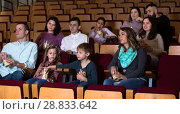 Купить «Emotional audience eating popcorn and watching a movie», фото № 28833642, снято 3 декабря 2016 г. (c) Яков Филимонов / Фотобанк Лори