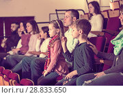 Купить «Ordinary group expecting movie to begin», фото № 28833650, снято 3 декабря 2016 г. (c) Яков Филимонов / Фотобанк Лори