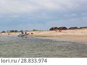 Купить «Рыбацкая лодка у пляжа курортного посёлка Витино, Крым», фото № 28833974, снято 28 июня 2018 г. (c) Николай Мухорин / Фотобанк Лори