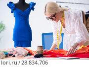 Купить «Woman tailor working on new dress designs», фото № 28834706, снято 13 апреля 2018 г. (c) Elnur / Фотобанк Лори