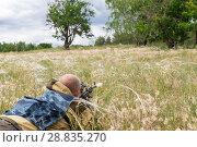 Купить «Hunting season. A 35-40-year-old man hunts and targets a firearm in the grass.», фото № 28835270, снято 10 июня 2018 г. (c) Светлана Евграфова / Фотобанк Лори