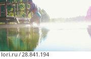 Купить «Muscular man climbs the stairs from the blue lake», видеоролик № 28841194, снято 20 ноября 2019 г. (c) Константин Шишкин / Фотобанк Лори