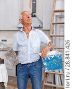Купить «Man determining scope of plastering works», фото № 28841426, снято 19 июня 2018 г. (c) Яков Филимонов / Фотобанк Лори