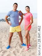 Купить «Sporty couple posing after outdoors workout», фото № 28841462, снято 26 июня 2018 г. (c) Яков Филимонов / Фотобанк Лори
