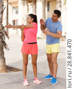 Купить «Woman on workout with trainer», фото № 28841470, снято 26 июня 2018 г. (c) Яков Филимонов / Фотобанк Лори