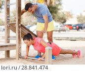 Купить «Woman on workout with trainer», фото № 28841474, снято 26 июня 2018 г. (c) Яков Филимонов / Фотобанк Лори