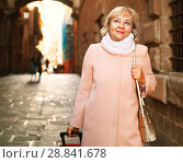 Купить «Cheerful woman with baggage in scarf», фото № 28841678, снято 27 ноября 2017 г. (c) Яков Филимонов / Фотобанк Лори