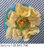 Купить «Nachos chips with guacamole», фото № 28841746, снято 20 августа 2018 г. (c) Яков Филимонов / Фотобанк Лори