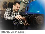 Купить «Male worker repairing shoe», фото № 28842586, снято 2 февраля 2017 г. (c) Яков Филимонов / Фотобанк Лори