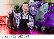 Купить «Adult worker displaying result of his work», фото № 28842594, снято 2 февраля 2017 г. (c) Яков Филимонов / Фотобанк Лори
