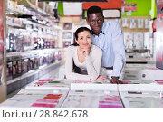 Купить «Couple standing in store of household appliances», фото № 28842678, снято 21 февраля 2018 г. (c) Яков Филимонов / Фотобанк Лори