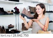 Купить «Portrait of happy female selecting loafers», фото № 28842750, снято 26 сентября 2016 г. (c) Яков Филимонов / Фотобанк Лори