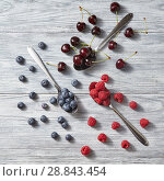 Freshly picked blueberry, cherry, raspberry on gray wooden background. Colorful organic berries pattern. Стоковое фото, фотограф Ярослав Данильченко / Фотобанк Лори