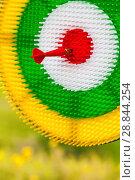 Купить «Red arrow in a multi-colored target», фото № 28844254, снято 22 июля 2018 г. (c) Игорь Овсянников / Фотобанк Лори
