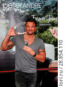 Купить «Peter Andre launches his new fragrance 'Forever Young' and signs copies of his 2017 calendar at the Orchards Shopping Centre in Taunton Featuring: Peter...», фото № 28854110, снято 11 марта 2017 г. (c) age Fotostock / Фотобанк Лори