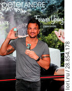 Купить «Peter Andre launches his new fragrance 'Forever Young' and signs copies of his 2017 calendar at the Orchards Shopping Centre in Taunton Featuring: Peter...», фото № 28854178, снято 11 марта 2017 г. (c) age Fotostock / Фотобанк Лори