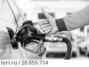Купить «Petrol or gasoline being pumped into a motor vehicle car. Closeup of man, showing thumb up gesture, pumping gasoline fuel in car at gas station.», фото № 28859714, снято 30 апреля 2014 г. (c) Matej Kastelic / Фотобанк Лори