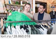 Купить «Couple is choosing jacket for her», фото № 28860018, снято 12 марта 2018 г. (c) Яков Филимонов / Фотобанк Лори