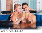 Купить «Romantic couple is relaxing with glasses of vine», фото № 28860062, снято 18 июля 2017 г. (c) Яков Филимонов / Фотобанк Лори