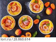 Купить «apricot clafoutis in ramekins on a tray», фото № 28860614, снято 22 июля 2018 г. (c) Oksana Zh / Фотобанк Лори