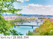 Купить «Cityscape of Lyon with bridges across the Rhone», фото № 28868394, снято 14 июля 2017 г. (c) Сергей Новиков / Фотобанк Лори