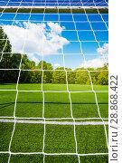Купить «Soccer net and football stadium empty field», фото № 28868422, снято 9 июля 2014 г. (c) Сергей Новиков / Фотобанк Лори