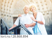 Купить «Loving mature spouses standing near ancient cathedral», фото № 28868894, снято 20 сентября 2018 г. (c) Яков Филимонов / Фотобанк Лори