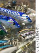 Купить «Image of variety fishing lures in the sports shop», фото № 28869014, снято 16 января 2018 г. (c) Яков Филимонов / Фотобанк Лори