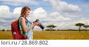 Купить «woman with backpack and camera over savannah», фото № 28869802, снято 25 июля 2015 г. (c) Syda Productions / Фотобанк Лори