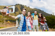 Купить «friends with backpack taking selfie by smartphone», фото № 28869806, снято 25 июля 2015 г. (c) Syda Productions / Фотобанк Лори
