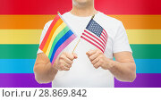 Купить «man with gay pride rainbow and american flag», фото № 28869842, снято 2 ноября 2017 г. (c) Syda Productions / Фотобанк Лори