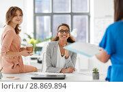 Купить «businesswomen at presentation in office», фото № 28869894, снято 17 марта 2018 г. (c) Syda Productions / Фотобанк Лори