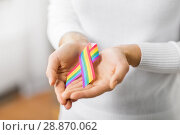 Купить «female hands holding gay pride awareness ribbon», фото № 28870062, снято 14 ноября 2017 г. (c) Syda Productions / Фотобанк Лори