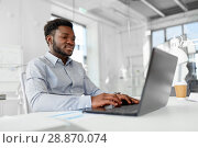 Купить «african american businessman with laptop at office», фото № 28870074, снято 7 апреля 2018 г. (c) Syda Productions / Фотобанк Лори