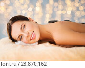 Купить «beautiful woman having hot stone therapy at spa», фото № 28870162, снято 25 июля 2013 г. (c) Syda Productions / Фотобанк Лори